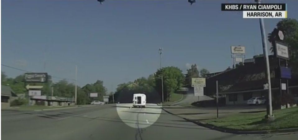 Video from a dash cam captures a 4-year-old girl falling out of the back of a moving bus.
