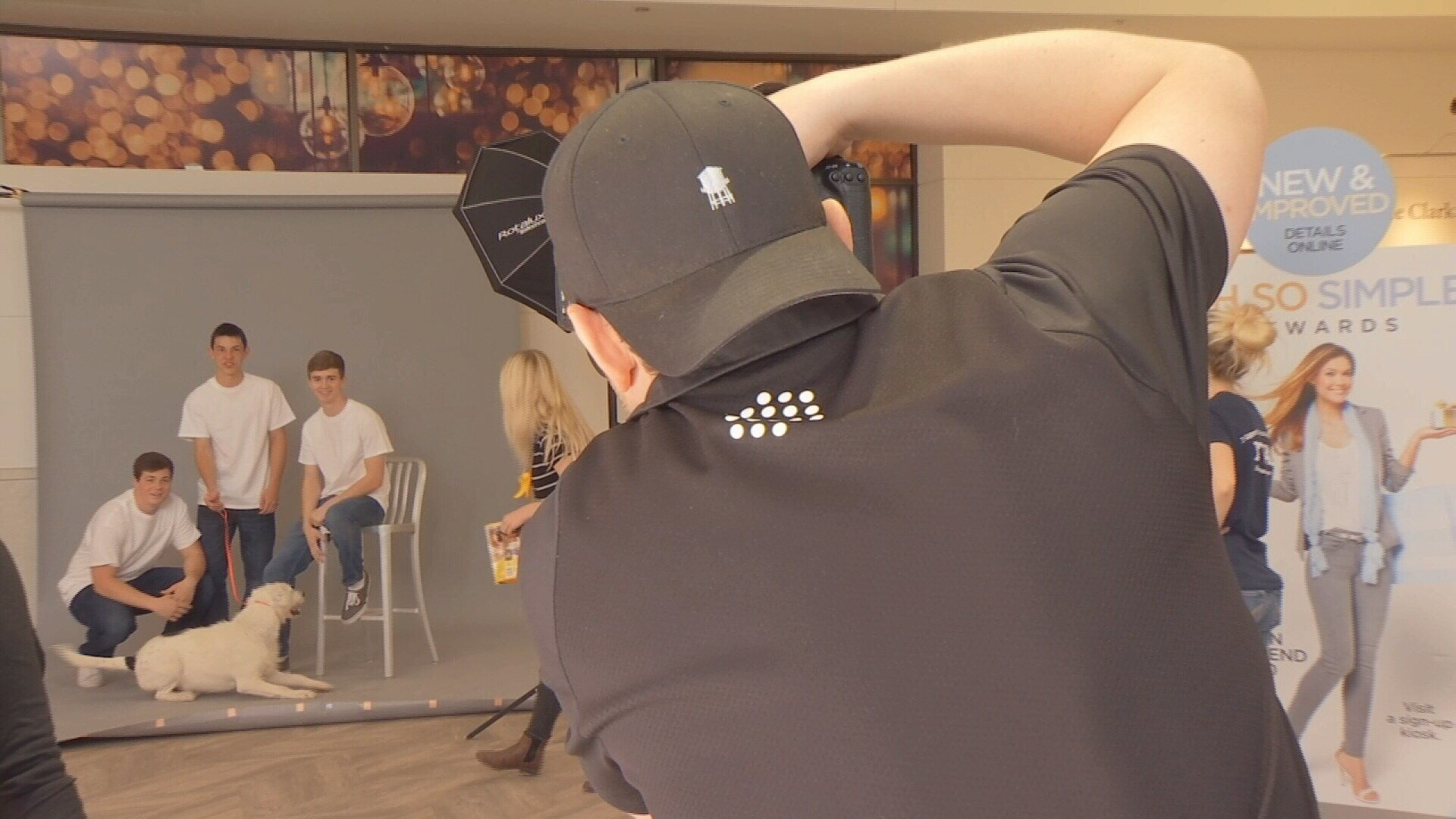 Rudi Marten shooting pictures at Rimrock Mall on Sunday.
