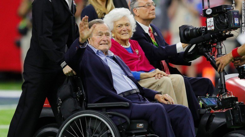 Former President George H.W. Bush and Barbara Bush arrive for the coin toss prior to Super Bowl 51 between the Atlanta Falcons and the New England Patriots at NRG Stadium on February 5, 2017, in Houston.
