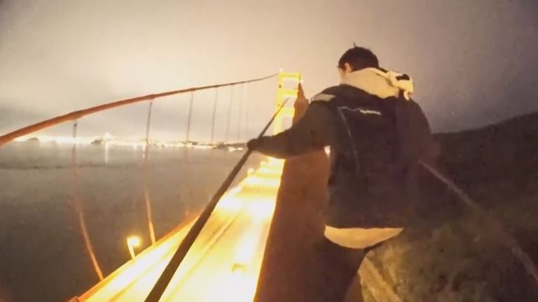 Peter Teatime and his friend Tommy Rector dodged the bridge's security systems and climbed the 746 foot-high structure with no safety equipment. / CBS SF