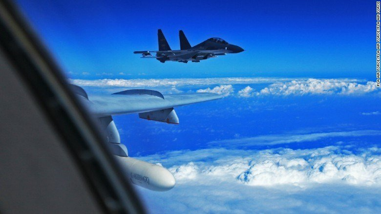 A file image of two Chinese Su-30 fighter jets. The same type of jets were said to have intercepted a US WC-135 Wednesday, according to the US. (CNN photo)
