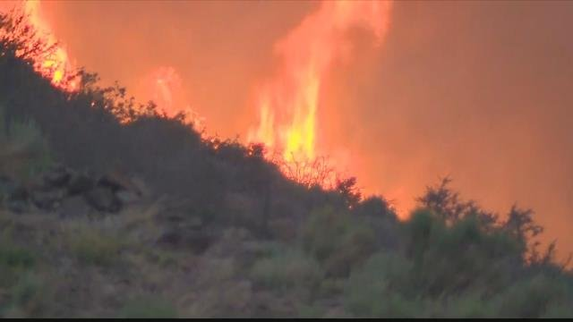 The high temps are being blamed for sparking a large wildfire that's burning in California. (CBS News photo)