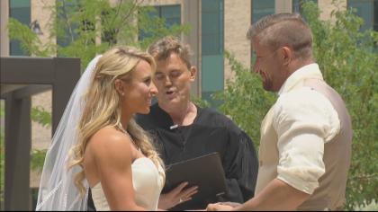 """Jourdan and Kit Bargmann say """"I do"""" at their hospital ceremony. (CBS)"""