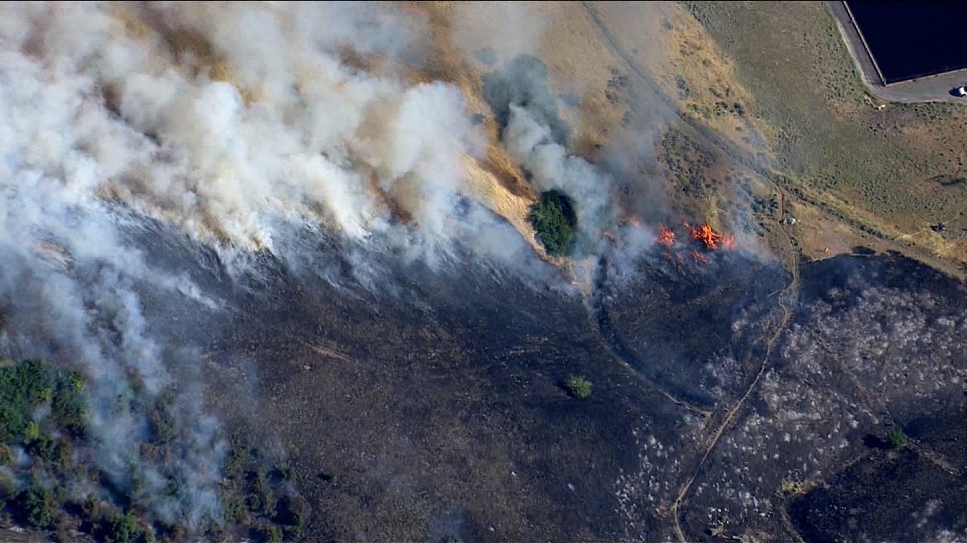 In Utah, fires continued with little rain relief in sight. Ten communities have been evacuated, officials said. (Credit: KSL)