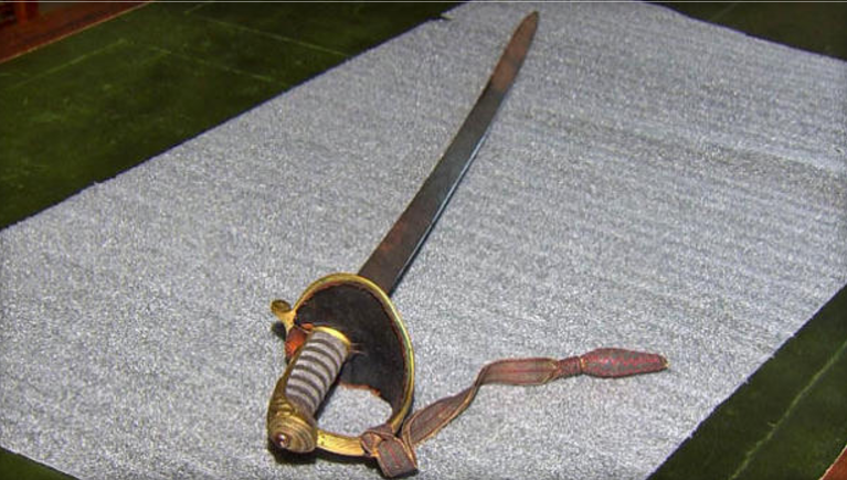 The long-lost sword of Civil War Col. Robert Gould Shaw is seen in a segment broadcast on CBS Boston station WBZ-TV on July 12, 2017, after the sword was found in an attic. (WBZ-TV)