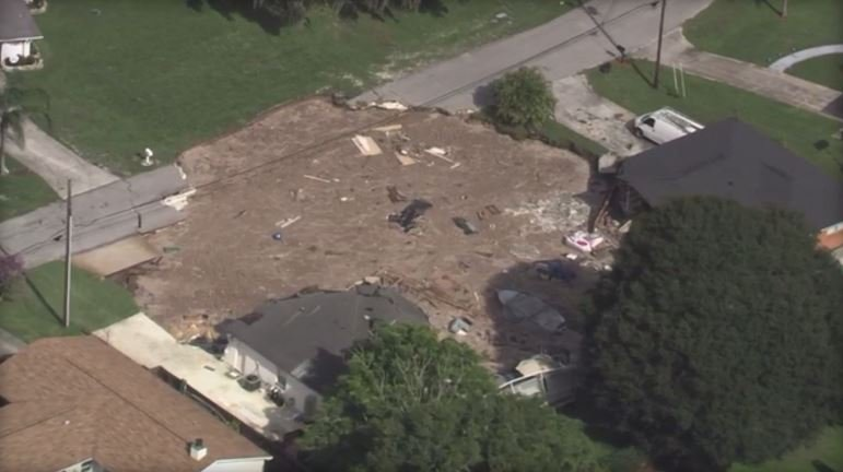 Homes were evacuated after a sinkhole formed Friday morning in a Land O' Lakes, Florida, neighborhood. WTSP-TV