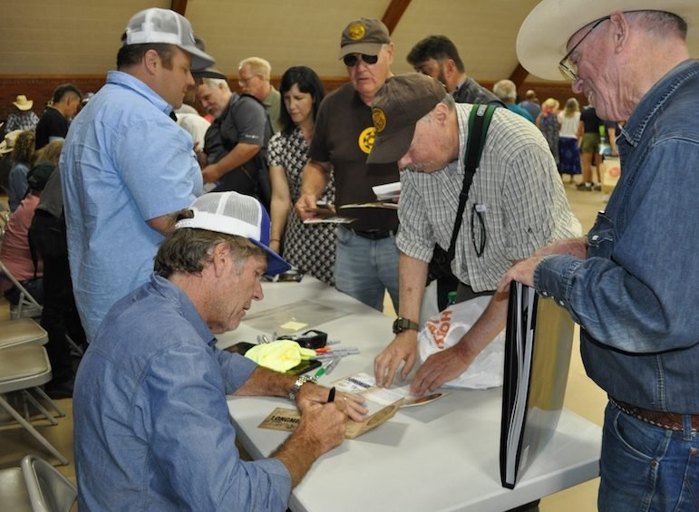 "Actors Robert Taylor (who plays Sheriff Walt Longmire, lower left) and Adam Barkley (Deputy Jim ""The Ferg"" Ferguson) meet fans and sign autographs for hours at Bomber Mountain Civic Center recent in Buffalo, Wyo. (Steve Prosinski photo)"