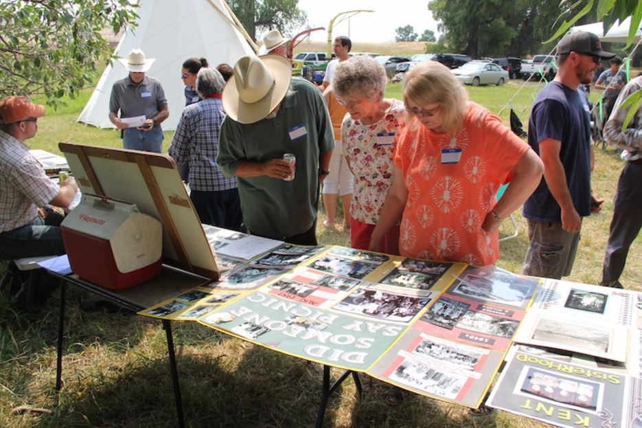 Families members examine old photos, documents and scrapbooks at the reunion. (Ed Kemmick/Last Best News)