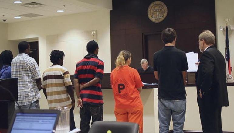 Misdemeanor arraignments, conducted en masse, in Cordele, Ga. CBS NEWS