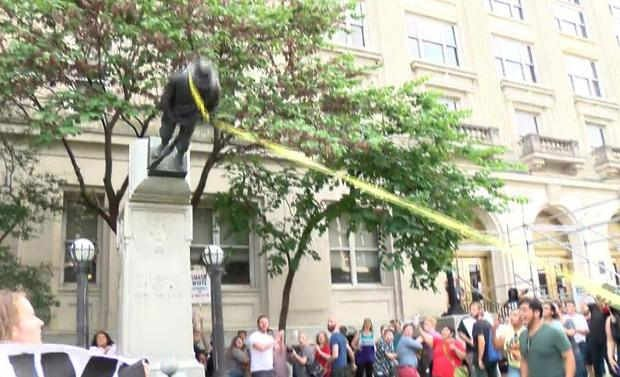 Protesters have toppled a statue of a Confederate soldier during a rally against racism in North Carolina. WNCN-TV