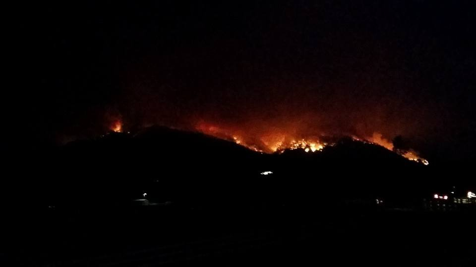 The Lolo Peak fire burning on 8.18.17 along Highway 12 west of Lolo. (photo credit: Christi Thorsell)