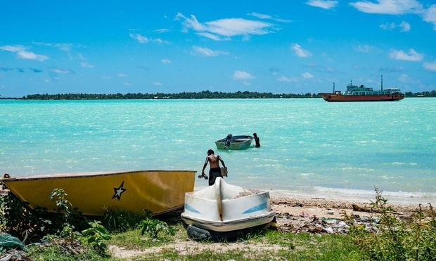 The turquoise Kiribati sea is central to the lives of Kiribati residents, and an ever-increasing threat to the future of their homeland. (CBS News)
