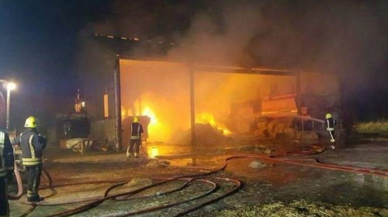 The fire at the farm burned about 60 tons of hay. PEWSEY FIRE STATION / BBC NEWS