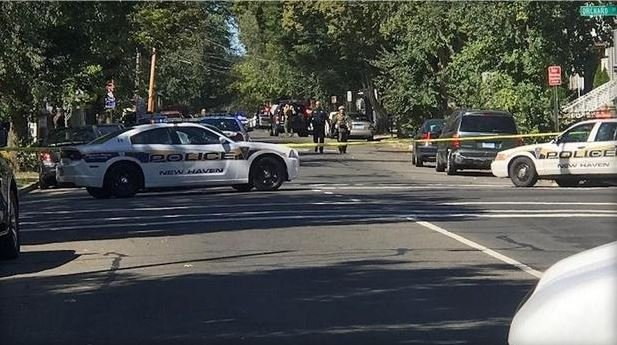 Two police officers shot, gunman barricaded in house