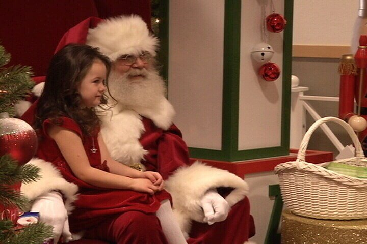 Santa visits with a child at Holiday Village Mall (MTN News photo)