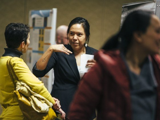 McNair scholar and Montana State University student Celina Brownotter explains her research to students and faculty during the seventh annual McNair Scholars Program research symposium on Monday, Dec. 5, 2016. MSU photo by Adrian Sanchez-Gonzalez.
