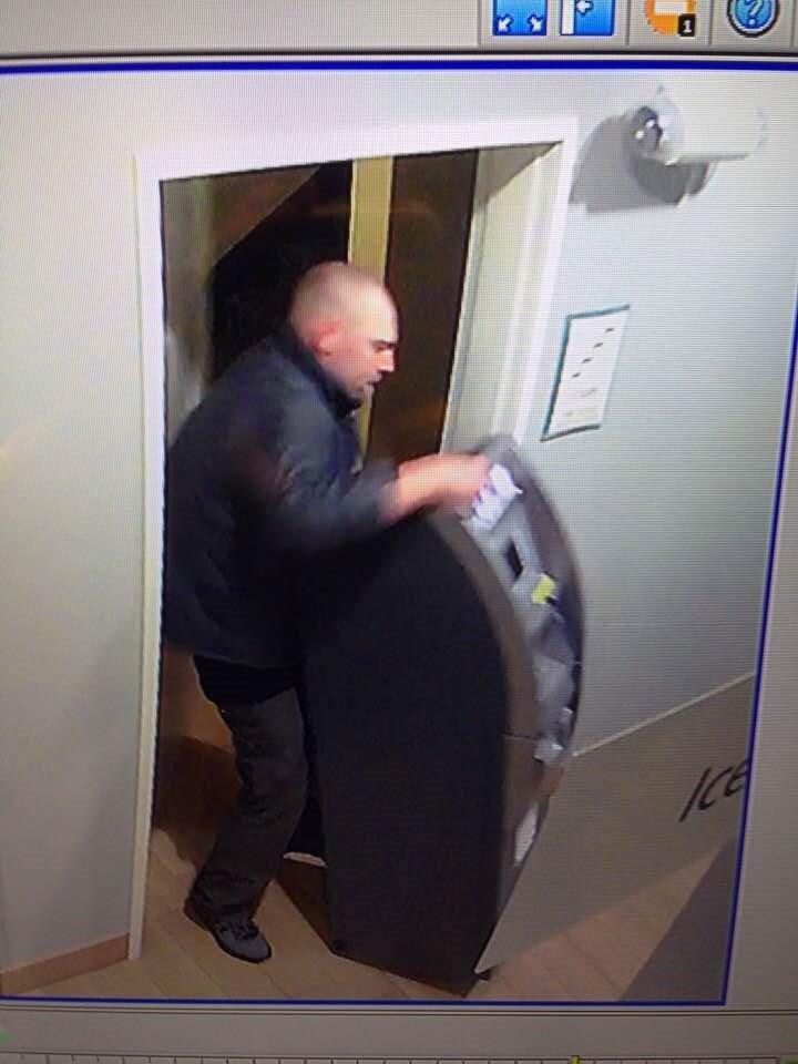 The photo shows a man taking the ATM (Linnell)