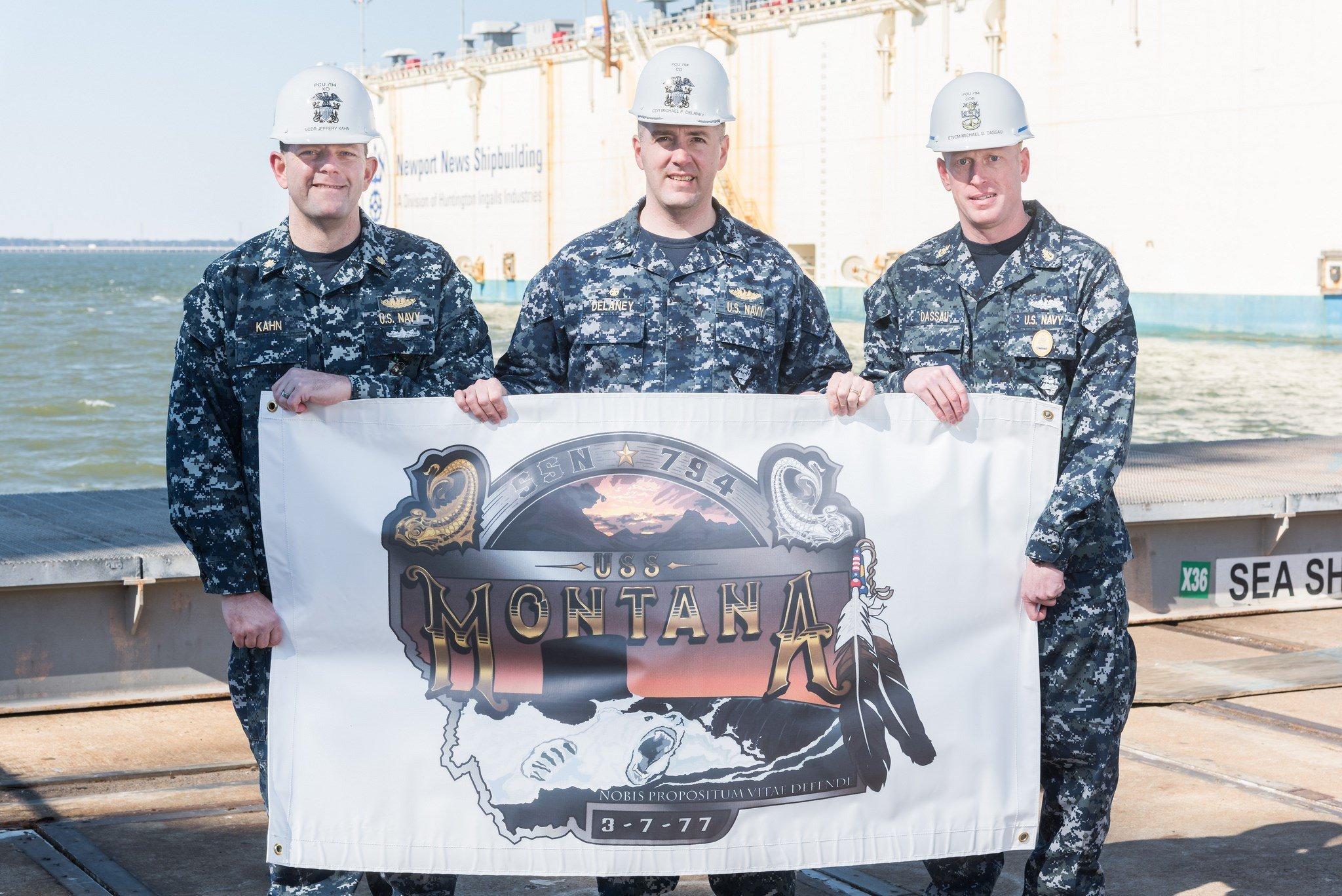 Left to Right: Lt. Cmdr. Jeffrey Kahn, Cmdr. Michael Delaney, and Senior Chief Petty Officer Michael Dassau