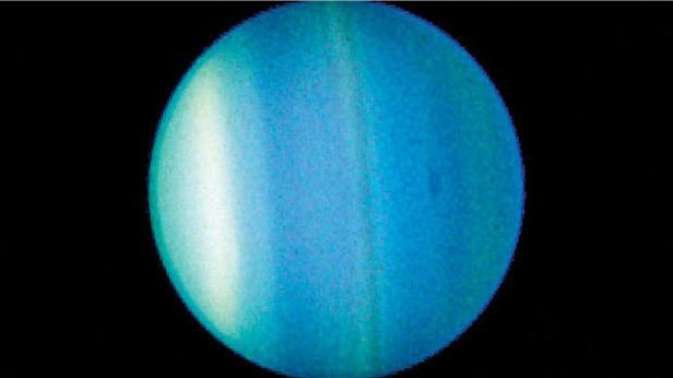 A 2006 image taken by the Hubble Space Telescope that shows bands and a dark spot in Uranus' atmosphere. NASA/SPACE TELESCOPE SCIENCE INSTITUTE