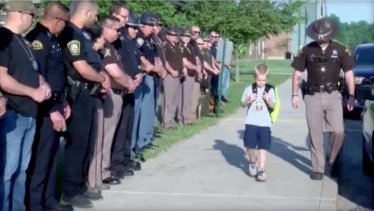 5-year-old Indiana boy Dakota Pitts got a police escort to school after his dad was killed in the line of duty. / WTHI