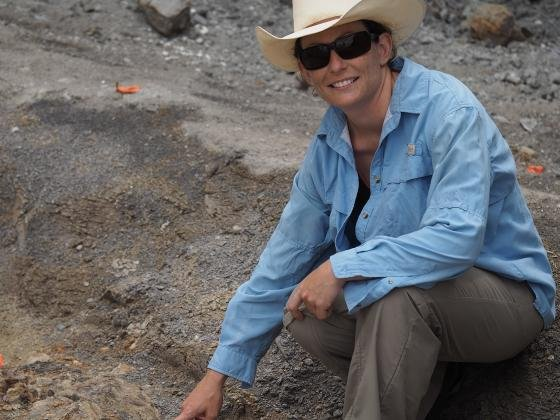 "Holly Woodward points at a Maiasaura fossil. Decades of research on Montana's state fossil -- the ""good mother lizard"" Maiasaura peeblesorum – has resulted in the most detailed life history of any dinosaur known and created a model to which all other dino"